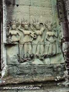 The Dancers, performing Apsara dance. Many of this image covers up the wall of Angkor Wat