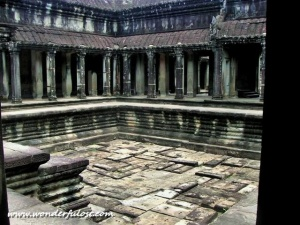 An ancient swimming pool inside Angkor Wat